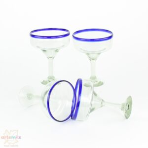 set of blue rimmed margarita glasses displayed with some glasses standing and some on their sides