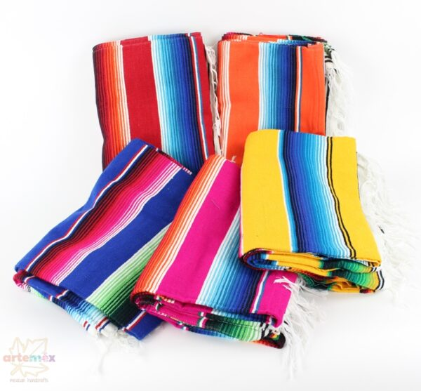 group of colorful mexican serape blankets folded decoratively