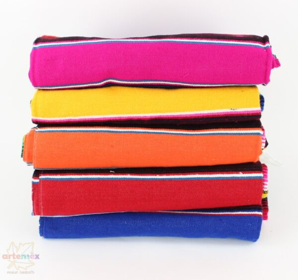 stack of authentic mexican serape blankets in an assortment of bright colors