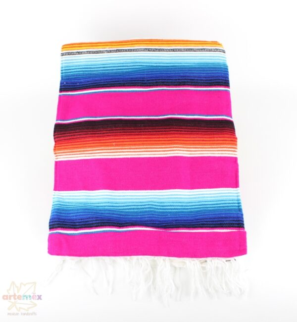hot pink mexican serape blanket with blue and orange accents and white fringe